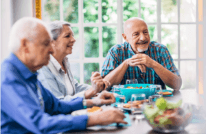 happy elderly people eating dietary protein for improving their health